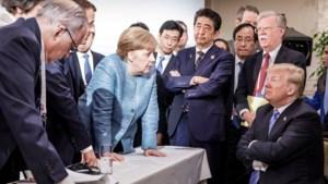 """Merkel spaart kritiek niet, Macron betreurt """"woedeaanval"""" van Trump"""