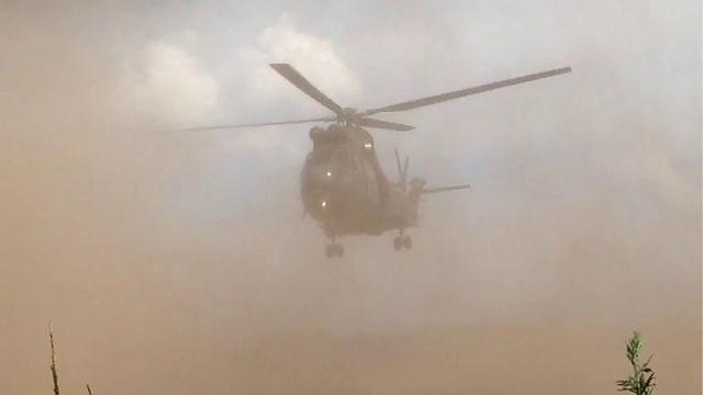 Toeschouwers happen stof als Britse militairen vertrekken van maïsveld in Kasterlee