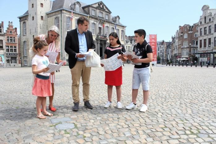 Babyreus Mit en schrijver Felix nemen kinderen op sleeptouw in binnenstad