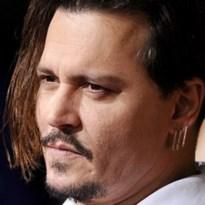 Bezwarende sms'jes brengen Johnny Depp in nauwe schoentjes