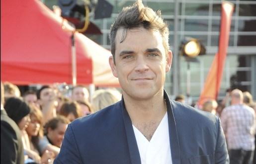 """Robbie Williams: """"Je lijkt wel lid van een boysband"""""""