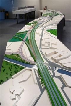 Maquette van 6 meter geeft stationsproject weer